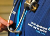 A doctor holds her stethoscope in an outpatients ward at a hospital in London