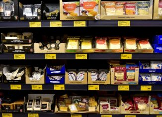 A range of various cheeses on sale in an Aldi store in London