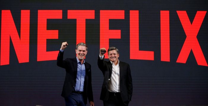 Reed Hastings co-founder and CEO of Netflix and Ted Sarandos Netflix chief content officer pose for photographs during a news conference in Seoul