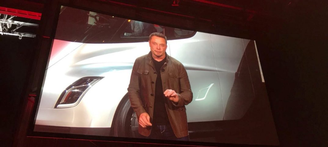 Tesla CEO Musk is shown on a large screen as he unveils the Tesla Semi during a presentation in Hawthorne