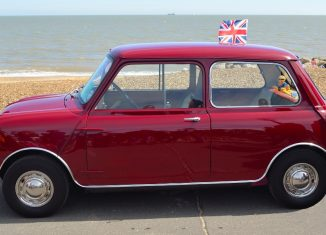 lassic Red Austin Mini motor car parked on Felixstowe seafront promenade