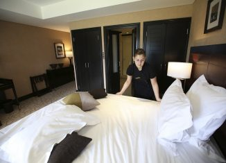 Housekeeping, one of service section works in decline - Image:REUTERS