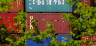 Shipping containers are stacked at the Paul W. Conley Container Terminal in Boston - Image: REUTERS/Brian Snyder