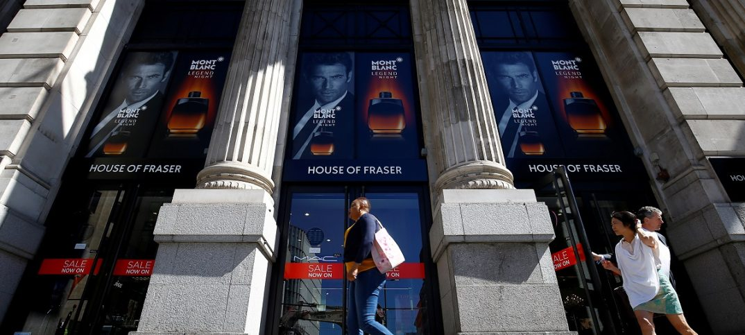 Shoppers walk past the King William Street branch of House of Fraser in central London. Image: REUTERS/Henry Nicholls