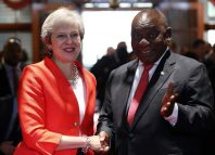 Britain's Prime Minister Theresa May is greeted by South African President Cyril Ramaphosa in Cape Town, South Africa. Image: REUTERS/Mike Hutchings