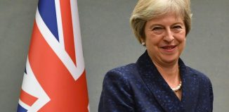 "May: ""Once Great Britain leaves the E.U., it will become one of the most business-friendly economies in the world."". Image: Angela Weiss/AFP/Pool via REUTERS"
