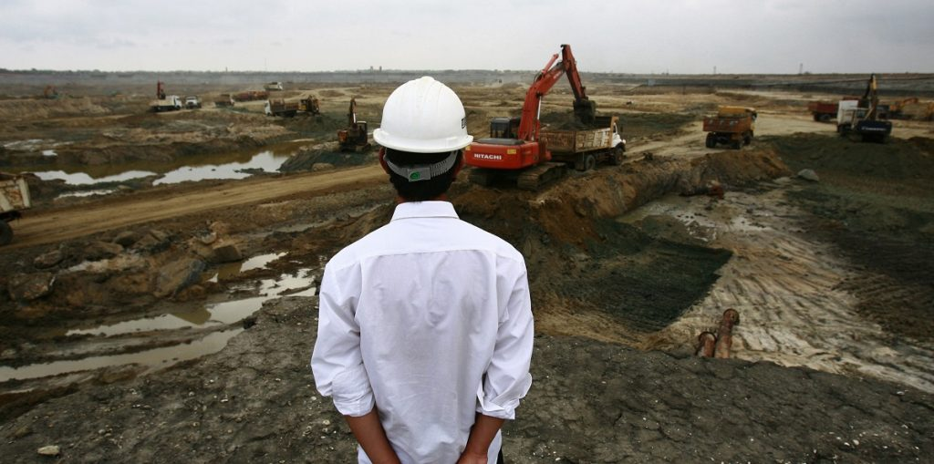 A Chinese engineer looks over the construction site for the deep water shipping port in Hambantota. 2010. REUTERS/Andrew Caballero-Reynolds