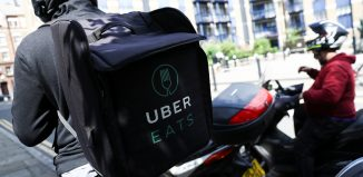 A scooter driver prepares to delivery an Uber Eats food order in London, Britain June 8, 2018. REUTERS/Simon Dawson