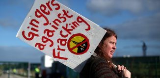 A protester stands outside Cuadrilla's Preston Road fracking site near Blackpool, Britain, October 22, 2018. (image: REUTERS/Hannah McKay)