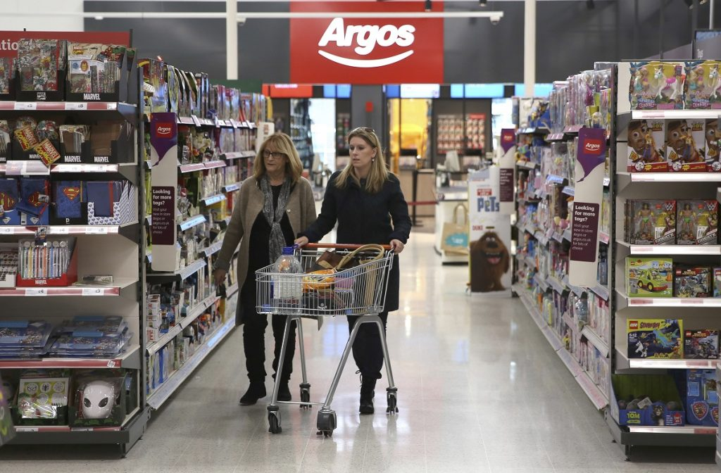 Sainsbury's, bought catalogue retailer Argos and has begun placing Argos outlets in some of its stores. Argos combines physical shops, ecommerce and home delivery. (image: REUTERS/Neil Hall)