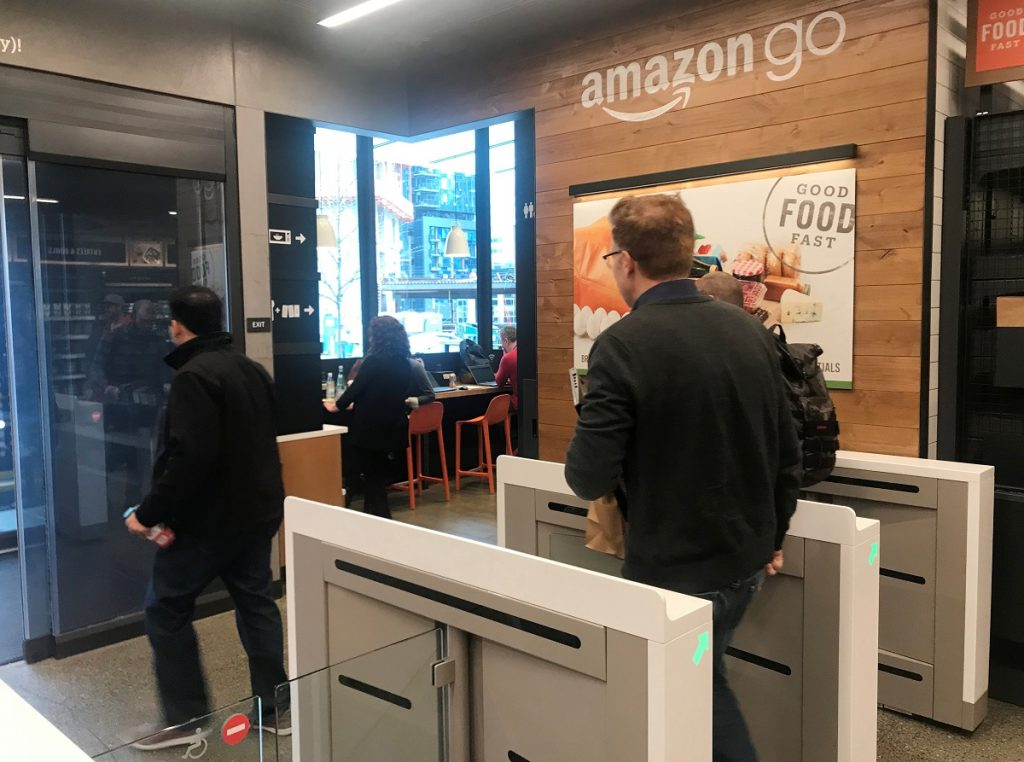 A customer walks out of the Amazon Go store, without needing to pay at a cash register due to cameras, sensors and other technology that track goods that shoppers remove from shelves and bill them automatically after they leave. (image: REUTERS/Jeffrey Dastin)