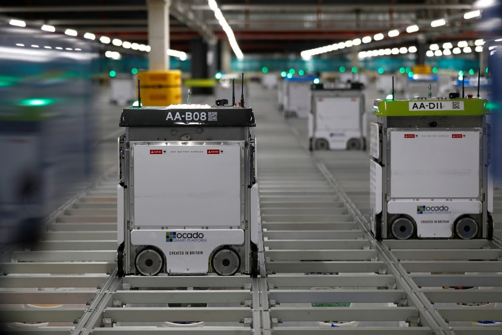 """Bots"" are seen on the grid of the ""smart platform"" at the Ocado Customer Fulfilment Centre. (image: REUTERS/Peter Nicholls)"