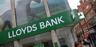 The largest High Street lender in Britain is undergoing a reorganization in order to better serve customers who prefer online banking to brick-and-mortar branches. (REUTERS/Toby Melville)
