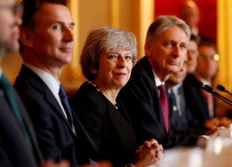 Britain's Prime Minister Theresa May sits with members of her cabinet